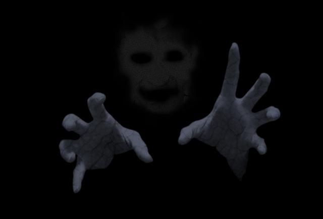 手を伸ばす幽霊